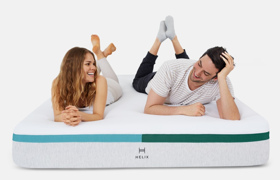 man and woman laying on stomach on helix mattress