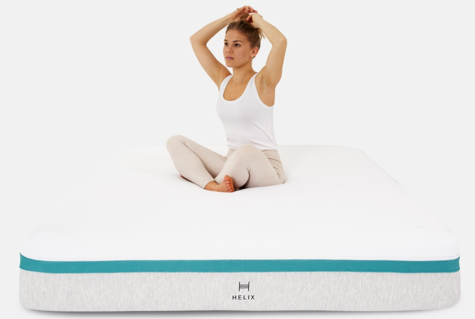 woman on helix mattress