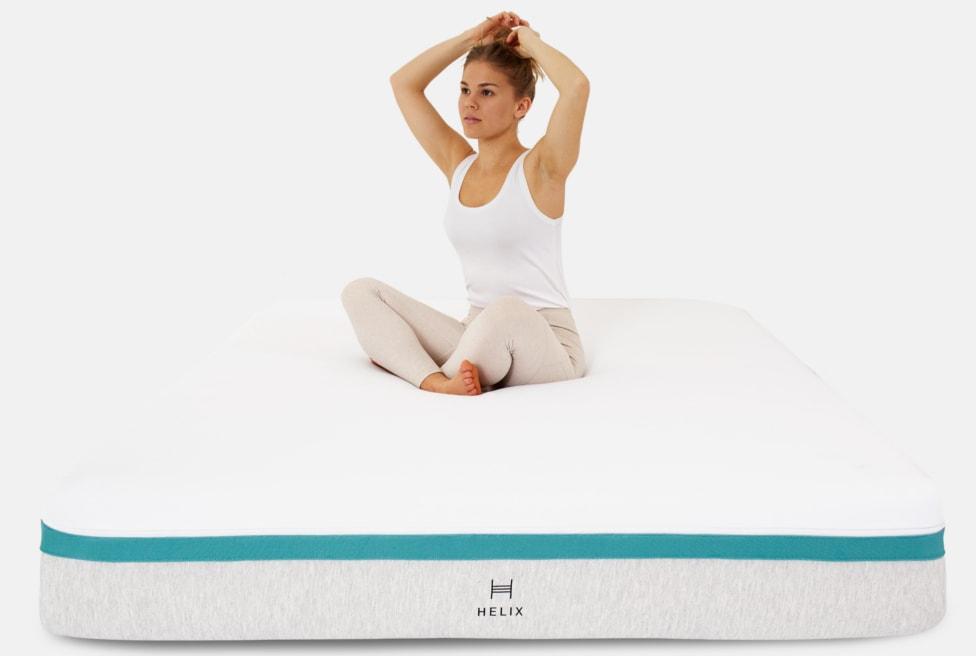 woman on helix mattress
