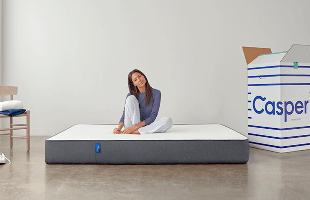 woman sitting on a casper mattress