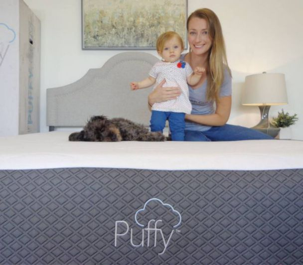 mom dog and baby on puffy mattress