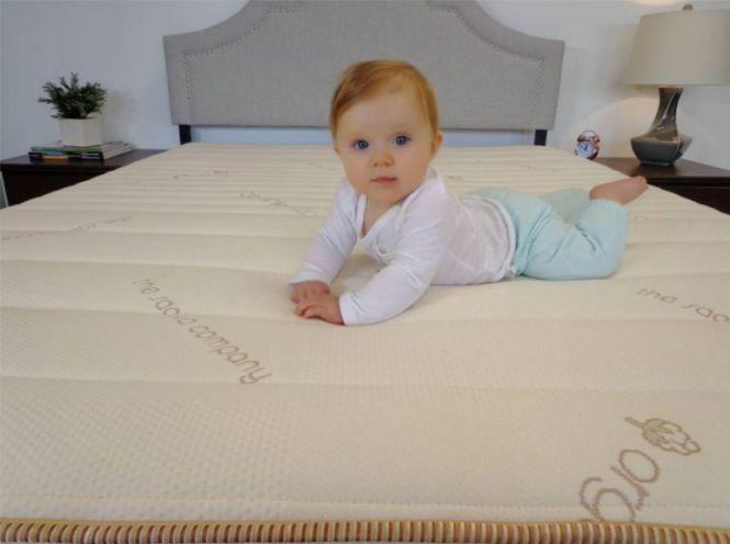 baby laying on a mattress
