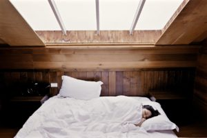 woman sleeping on bed in room