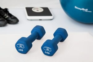 blue dumbells and black scale