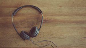 black headphones on wooden table
