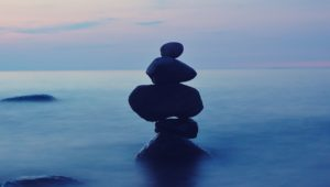 stacked stones with ocean background