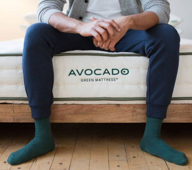 man sitting on an avocado mattress