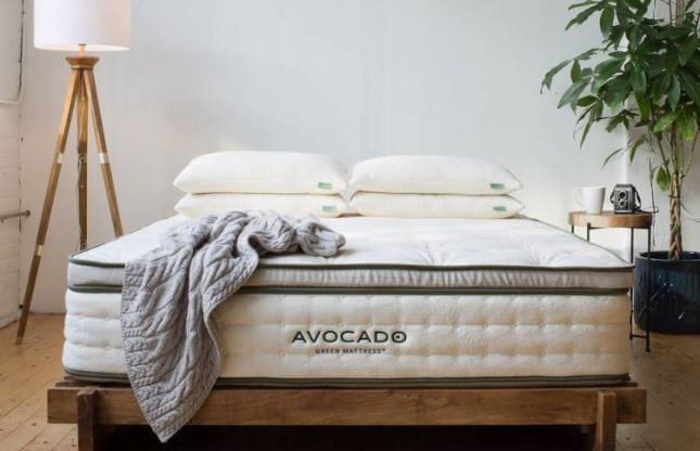 mattress with pillows with wooden decor