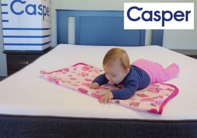 baby sleeping on a casper