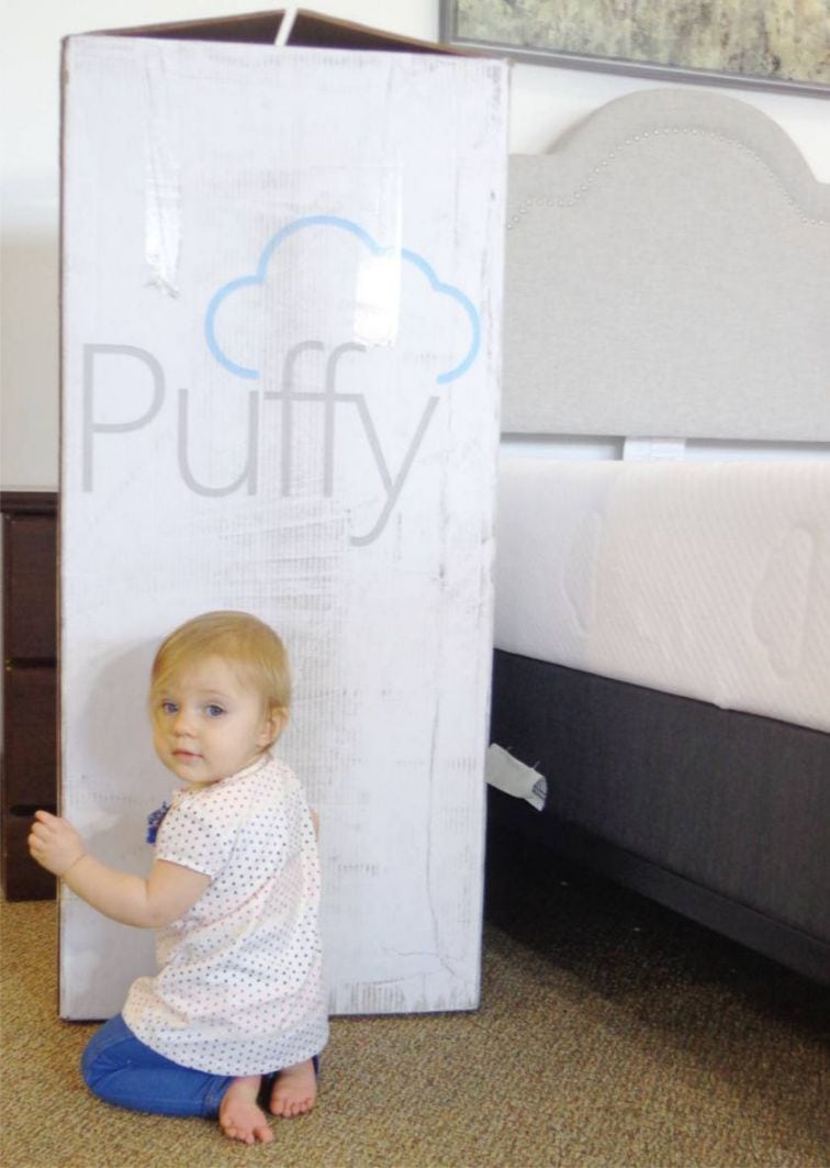 baby next to puffy box
