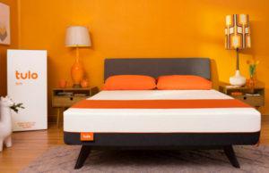 tulo soft mattress with bright orange wall