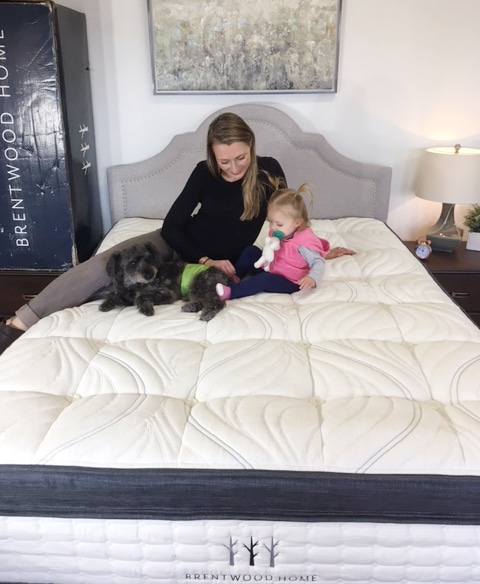 woman baby and dog on a brentwood mattress