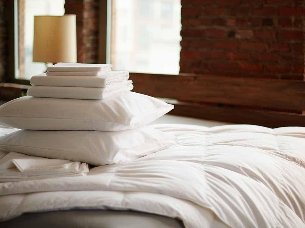 Pillows with folded sheets on top