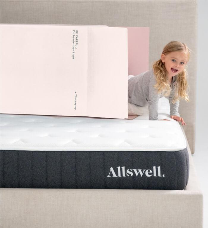 the allswell hyrbid mattress review - girl coming out of mattress box