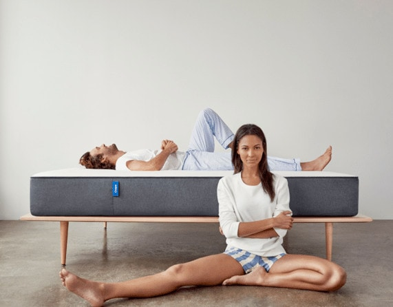 Couple laying near a mattress