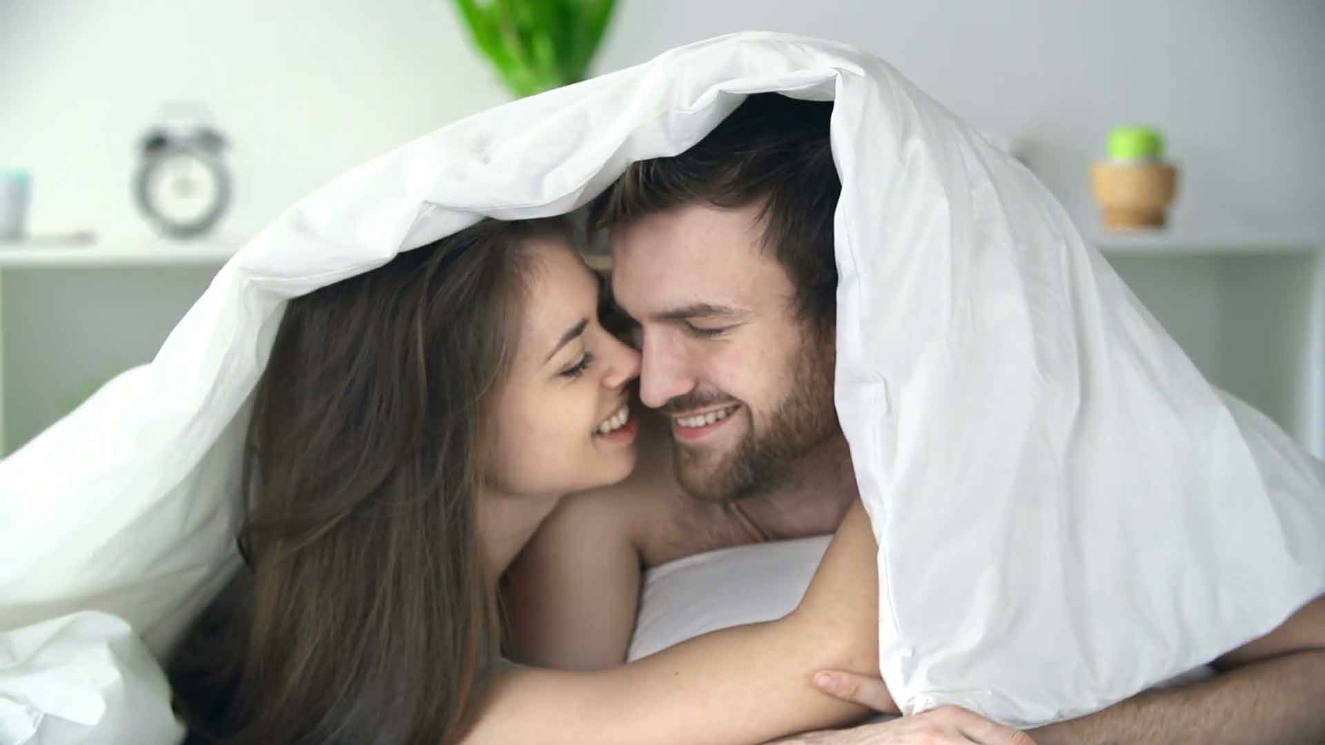 man and woman cuddling