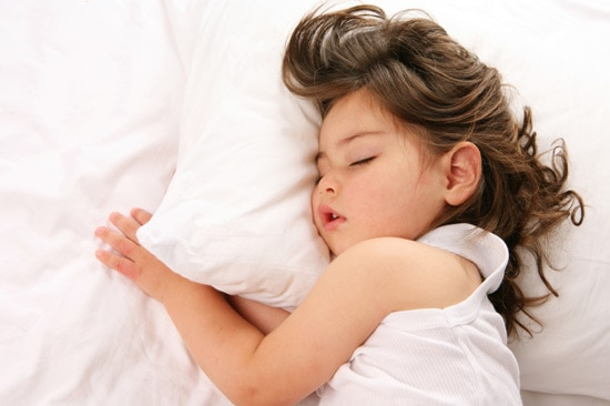 best mattresses for kids - little girl asleep on mattress