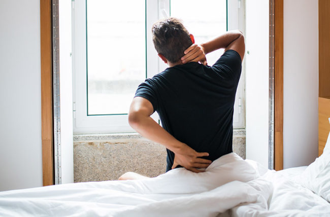 back pain caused by sleeping position