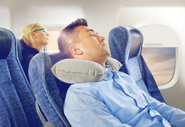 how to sleep on planes