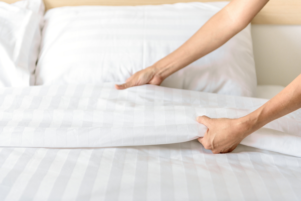 washing your sheets on a regular basis for better sleep