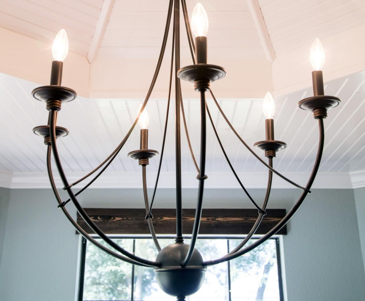 black iron light fixture for joanna gaines style bedroom