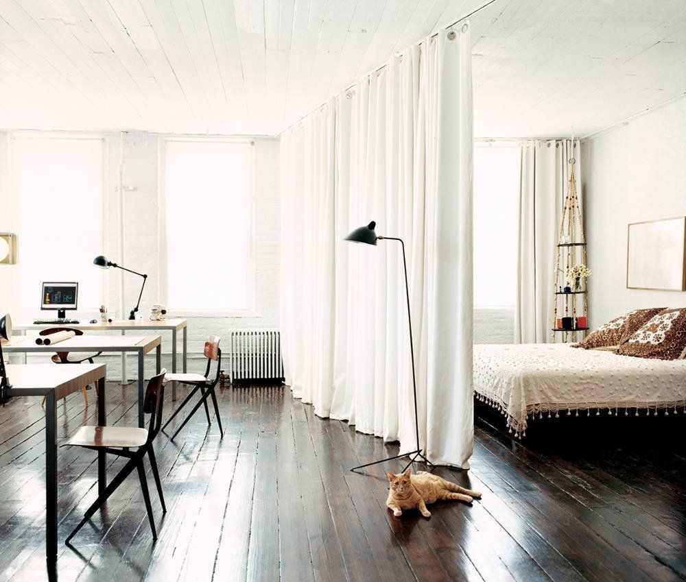 create a bedroom space in a studio apartnent