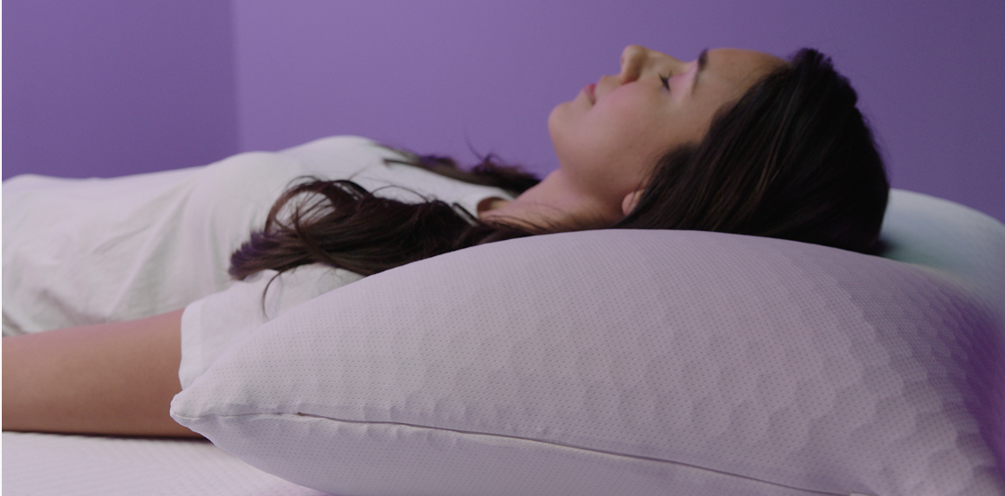 sleeping comfortably with a tall purple harmony pillow