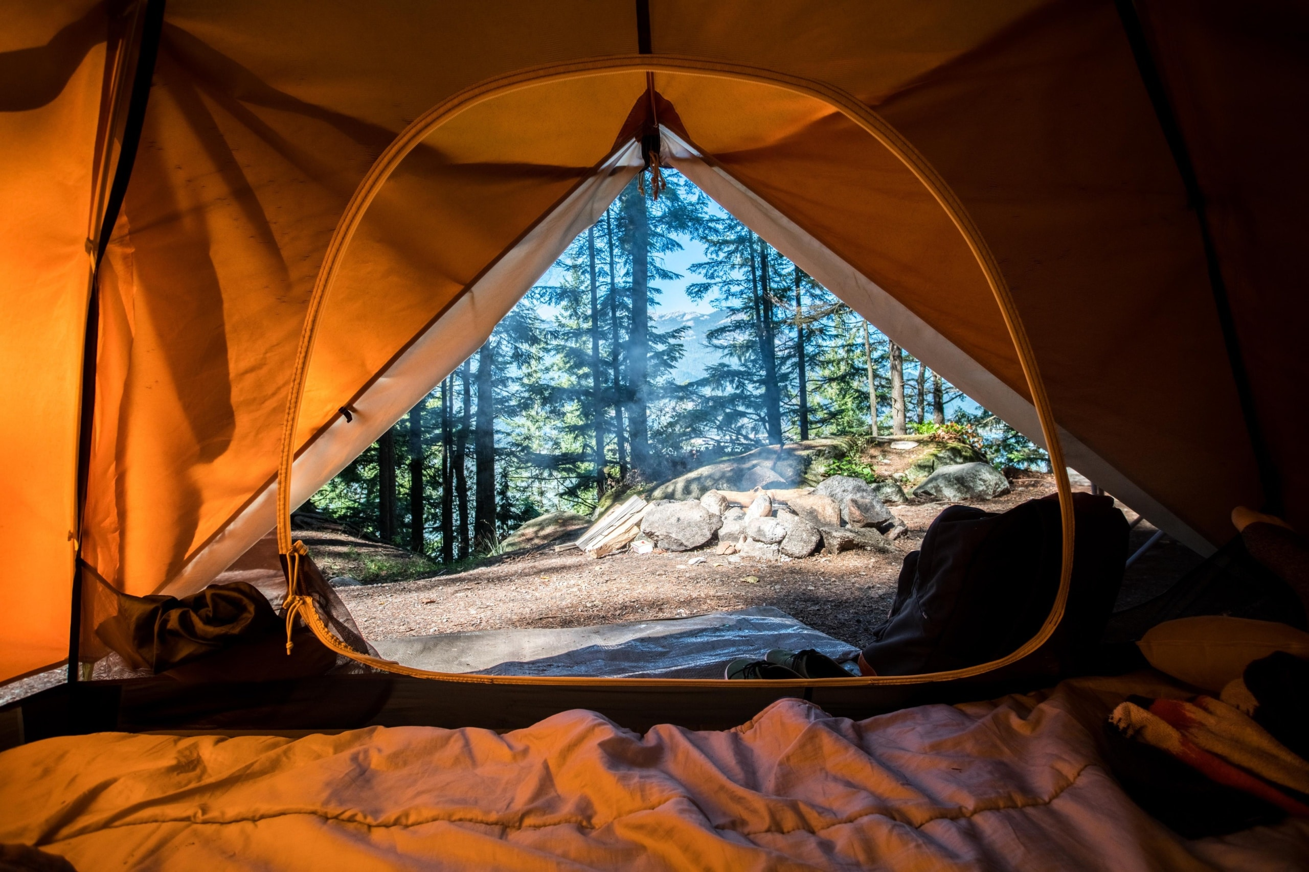 how to sleep better while camping