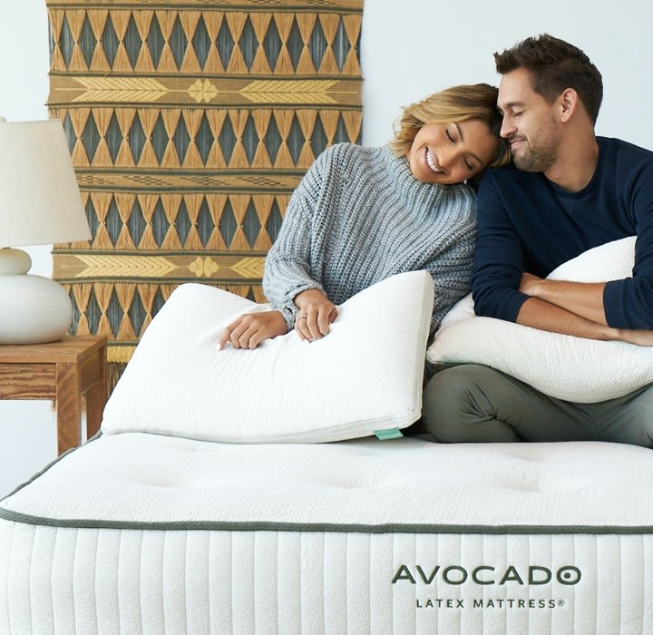 happy couple on avocado latex mattress